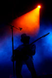 Stage with smoke and guitar player. Stage with light smoke and guitar player stock images