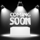 Stage, spot light projectors lightning the podium. Stage with the spot light projectors lightning the podium with -Coming Soon- message for your business Royalty Free Stock Photo