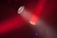 Stage spot lights with red beams in smoke Stock Photo