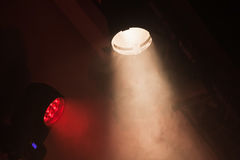 Stage spot lights with smoke in beams Stock Photography