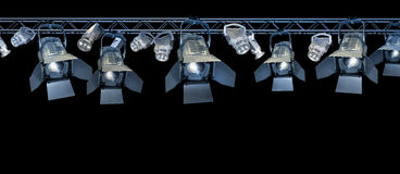 Stage spotlight rack. Professional stage spotlight lamps rack on black background stock images