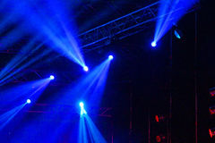 Stage Spotlight with rays. Concert lighting background Stock Photos