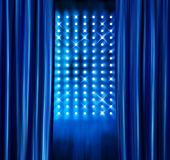 Stage spotlights blue curtains Royalty Free Stock Images