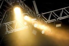 Stage spotlights through smoke Stock Photos