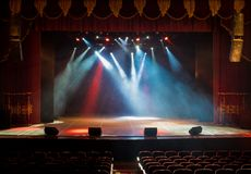 The stage of the theater illuminated by spotlights and smoke. From the auditorium Royalty Free Stock Photo