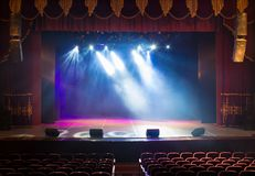 The stage of the theater illuminated by spotlights and smoke. From the auditorium Royalty Free Stock Images