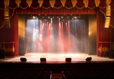 The stage of the theater illuminated by spotlights and smoke Stock Photography