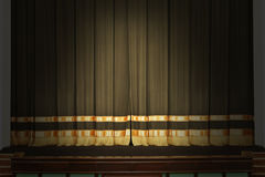 The stage in the theater with the lights off. The curtain on the stage in the theater with the lights off stock photos