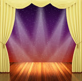 Stage with yellow  curtains and spotlight. Stock Photo