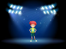 A stage with a young boy Royalty Free Stock Photography