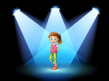 A stage with a young woman at the center Royalty Free Stock Images
