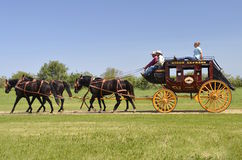 Stagecoach lead by a team of 4 horses Royalty Free Stock Photography