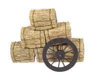 Stagecoach Wheel Leaning on Bales of Hay Stock Images