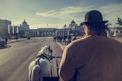 Stagecoaches with horses near Hofburg Palace, Vienna Royalty Free Stock Images