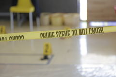 Staged crime scene. Crime scene tape in a classroom for demonstration royalty free stock photos