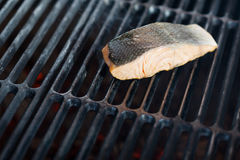 Stages of cooking salmon on the grill Stock Image