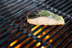 Stages of cooking salmon on the grill Stock Photo