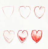 Stages of drawing heart, pencil Stock Image