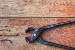 Stages of repair at home - to pull out the old nails Royalty Free Stock Photography