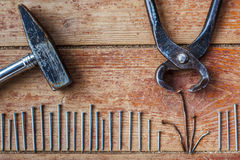 Stages of repair at home - to pull out the old nails Stock Images