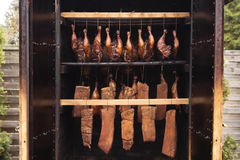 Stages of smoking. Ready-smoked meat in the smokehouse Royalty Free Stock Photography