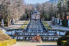 Staggered fountain in the gardens of the Granja of San Ildefonso. View of a large stepped fountain monuments and gardens of the Granja de San Ildefonso in the Royalty Free Stock Photos