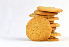 Staggered stack of homemade peanut butter cookies with one resting against it. Royalty Free Stock Photo