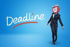 Staggering businessman with melting clock instead of head and DEADLINE sign on blue background. Final deadline. Time expired. Time planning royalty free stock photos