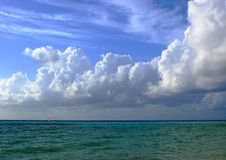 Staggering clouds. The Indian Ocean, blue sky and the staggering clouds stock photos