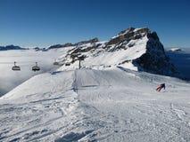 Staggering skier, Titlis region Royalty Free Stock Photos