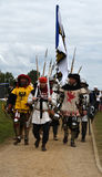 Impressive swords and beautiful colored costumes of medieval knights Royalty Free Stock Photography