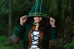 Staging photo of beautiful woman in fantasy suit with hood Stock Photography