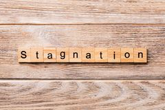 Stagnation word written on wood block. stagnation text on wooden table for your desing, concept.  royalty free stock photos