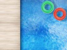 Stagno con gli anelli di nuotata Fotografie Stock