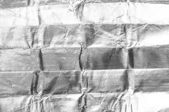 Stagnola d'argento strutturata e fondo Fotografia Stock