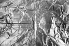 Stagnola d'argento strutturata e fondo Immagini Stock