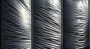 Stagnola del polietilene gonfiata il nero come fondo Fotografie Stock