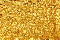 Stagnola di oro gialla brillante della foglia Fotografia Stock