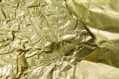 Stagnola dorata strutturata e fondo Fotografia Stock Libera da Diritti