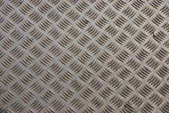 Stahldiamantplattenhintergrund stockfotografie