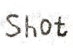Stahlschuß für Startenmaschine Aufschrift GESCHOSSEN auf einer weißen Oberfläche lizenzfreie stockfotografie