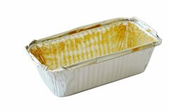 Stain of butter cake in empty aluminum tray on white background. Stain of butter cake in empty aluminum tray isolated on white background royalty free stock photo