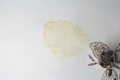 Stain on ceiling from rain. Damage caused by damp and moisture on a ceiling royalty free stock photos