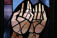 Stain Glass. Hands Stock Photo