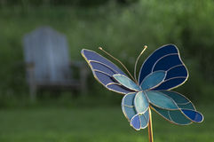 Stain Glass Butterfly. And Adirondack Chair Royalty Free Stock Photography