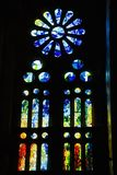 Stain glass of Sagrada Familia Holy Family Church by architect Antoni Gaudi, Barcelona, Spain begun in 1882 and continuing to be b Royalty Free Stock Photos