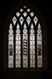 Stain Glass Window. A large stain glass window in a church hall Royalty Free Stock Photos