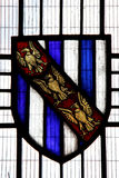 Stain glass window. Colourful image of a  Stain glass shield from St. Martin, flint stone Church in Chelsfield, Kent in England. The register of St. Martin dates Stock Photos