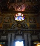 Stain Glass Window in Church. Famous stained glass window in Basilica in Rome, Italy Royalty Free Stock Images