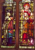 Stain glass window depicting a religious scene royalty free stock image